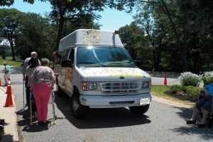 Residents of St. Joseph's Adult Care Home enjoyed Ice-Cream of the Good Humor truck in a hot s